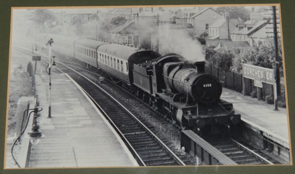 "Image for Photographic Print of ""Locomotive 6358 Passing Dorchester West Station."" GWR 6358, Class Code 4300, Designer Churchward, 2-6-0, Built 30/11/1923, Swindon Works (GWR/British Railways), 1948 Shed 82C Swindon, Last Shed 82D Westbury, Withdrawn 31/10/1959, Disposal details Swindon Works (B.R.) Disposal Cut Up, 31/03/1960."