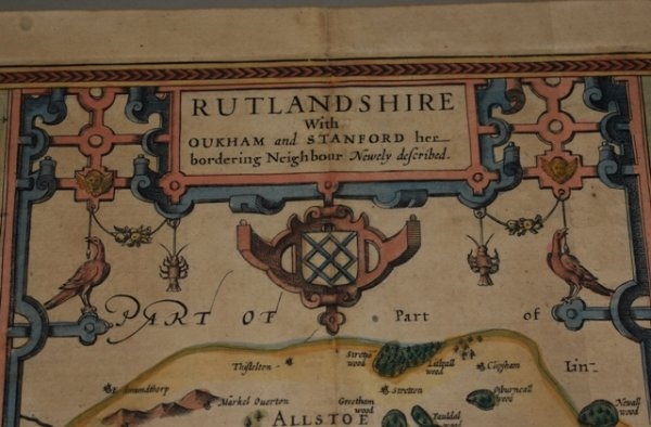 Image for RUTLANDSHIRE With OUKHAM and STANFORD... Original Antique Engraved Hand Coloured Map of RUTLANDSHIRE. With, Arms of Nobles and County Crest. Plan of County Towns OUKHAM and STANFORD. Illustrations of Scribes to bottom corners.