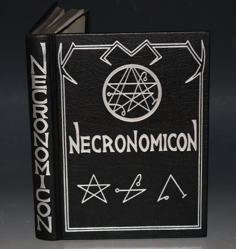 Image for THE NECRONOMICON. (Black Magic.) Edited & produced by Simon. A Scarce Title. This is the Rare Deluxe First Leather Limited Edition of the Necronomicon, edited & produced by Simon, with graphics by Barnes Graphics, Inc. Limited to 666 numbered copies, this one is number #69 for John Michell, and has been signed by L. Barnes, at the bottom of the acknowledgments page.